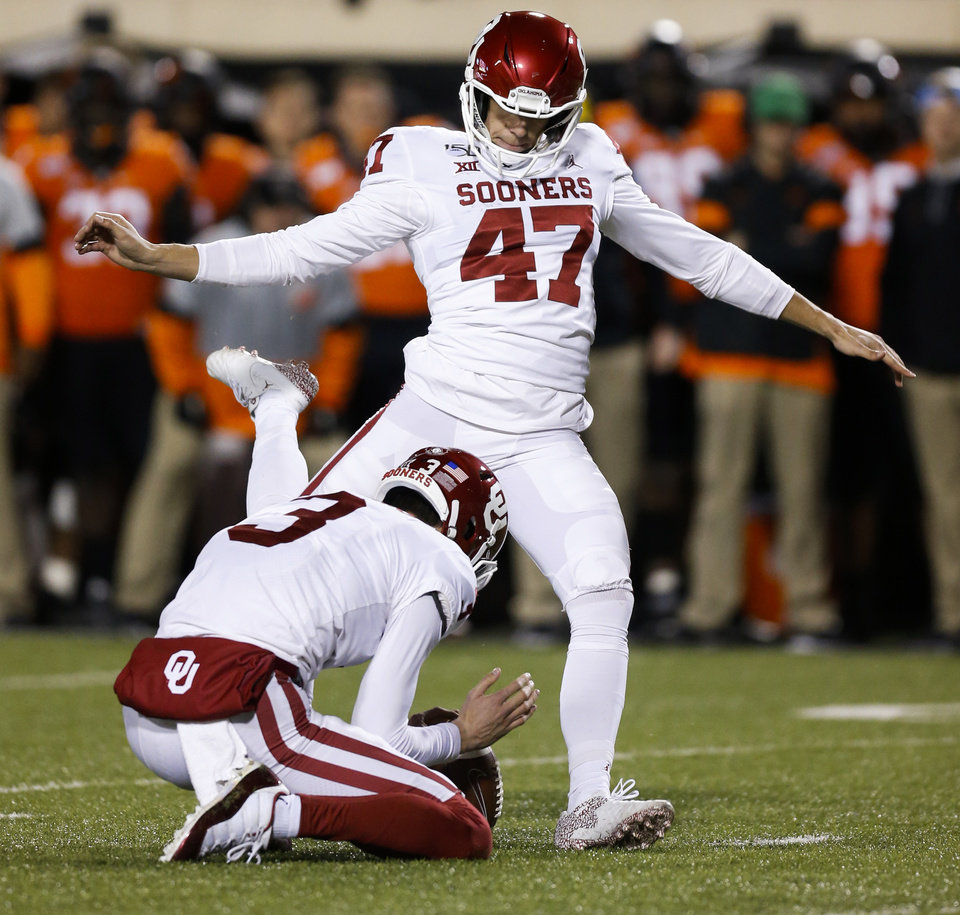 Photo - Oklahoma's Gabe Brkic (47) kicks a field goal as Connor McGinnis (3) holds in the second quarter during the Bedlam college football game between the Oklahoma State Cowboys (OSU) and Oklahoma Sooners (OU) at Boone Pickens Stadium in Stillwater, Okla., Saturday, Nov. 30, 2019. [Nate Billings/The Oklahoman]