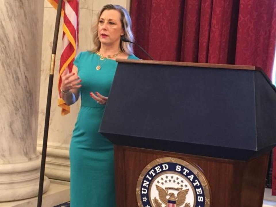 Photo -  U.S. Rep. Kendra Horn, of Oklahoma City, talks to the State Chamber of Oklahoma on Wednesday about marijuana banking and other issues. [Chris Casteel/The Oklahoman]