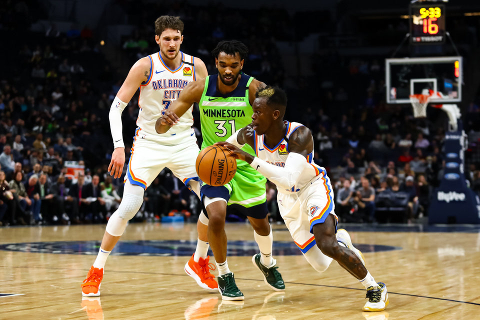 Photo - Jan 25, 2020; Minneapolis, Minnesota, USA; Oklahoma City Thunder guard Dennis Schroder (right) dribbles the ball past Minnesota Timberwolves forward Keita Bates-Diop (31) in the second quarter at Target Center. [David Berding/USA TODAY Sports]