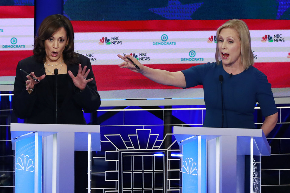 Photo - Democratic presidential candidate Sen. Kristen Gillibrand, D-N.Y., right, interrupts Sen. Kamala Harris, D-Calif., during the Democratic primary debate hosted by NBC News at the Adrienne Arsht Center for the Performing Arts, Thursday, June 27, 2019, in Miami. (AP Photo/Wilfredo Lee)