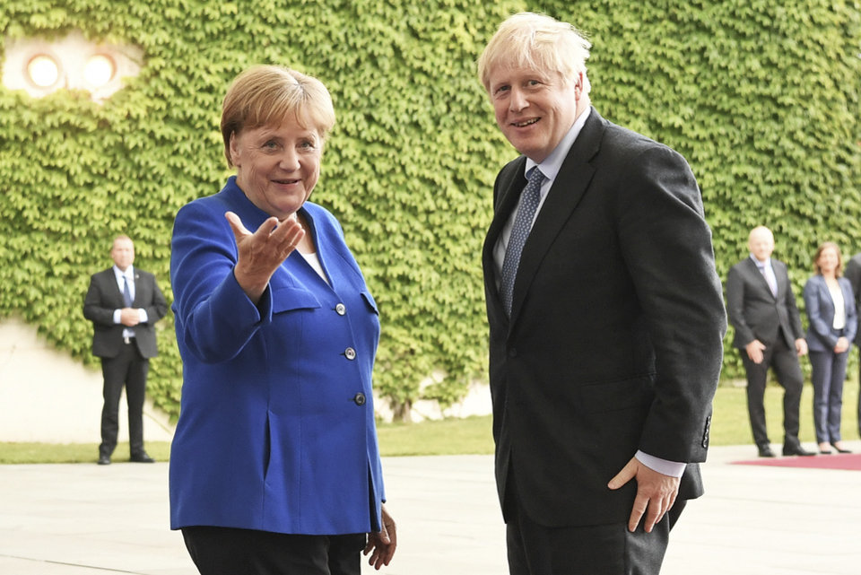 Photo -  Germany's Chancellor Angela Merkel meets with British Prime Minister Boris Johnson, in Berlin, Wednesday, Aug. 21, 2019. German Chancellor Angela Merkel says she plans to discuss with UK Prime Minister Boris Johnson how Britain's exit from the European Union can be