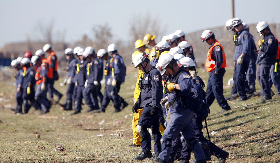 Photo - FEMA searches a field in Moore, Okla., Wednesday, May 22, 2013. Photo by Sarah Phipps, The Oklahoman