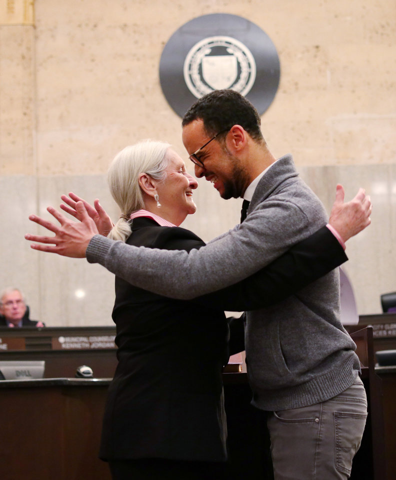Photo - New Ward 2 Councilman James Cooper and his mother, Cloise Cooper, embraced after she administered the ceremonial oath of office Tuesday at City Hall. Cooper's official swearing-in, by District 1 Oklahoma County Commissioner Carrie Blumert, was earlier in the morning. [Photo by Doug Hoke/The Oklahoman]