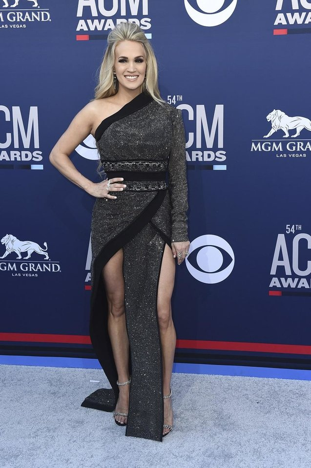 Photo - Carrie Underwood arrives at the 54th annual Academy of Country Music Awards at the MGM Grand Garden Arena on Sunday, April 7, 2019, in Las Vegas. (Photo by Jordan Strauss/Invision/AP)