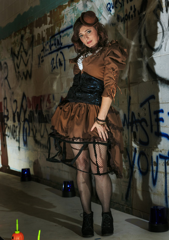 Photo - Heather is wearing Steampunk Vicky, which comes complete with a jacket, blouse, corset and skirt. Makeup by Ashley Tolman, The Makeup Room Agency. Photo by Chris Landsberger, The Oklahoman  CHRIS LANDSBERGER