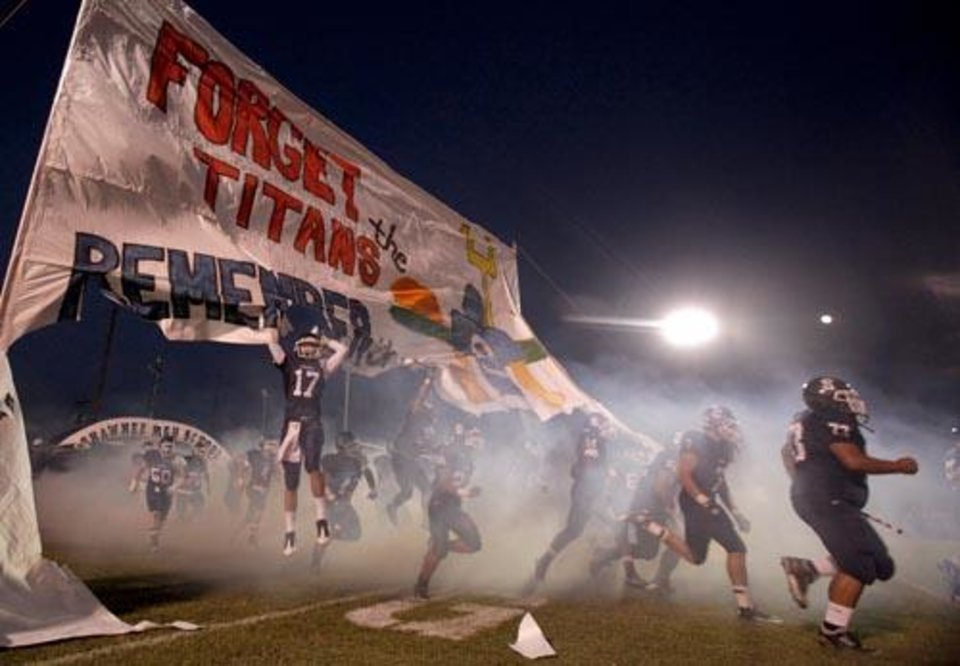Photo -  The Shawnee Wolves run onto the field before the high school football game between Shawnee and Carl Albert Friday, 0ct. 2, 2009, at the Jim Thorpe Stadium in Shawnee, Okla. Photo by Sarah Phipps, The Oklahoman