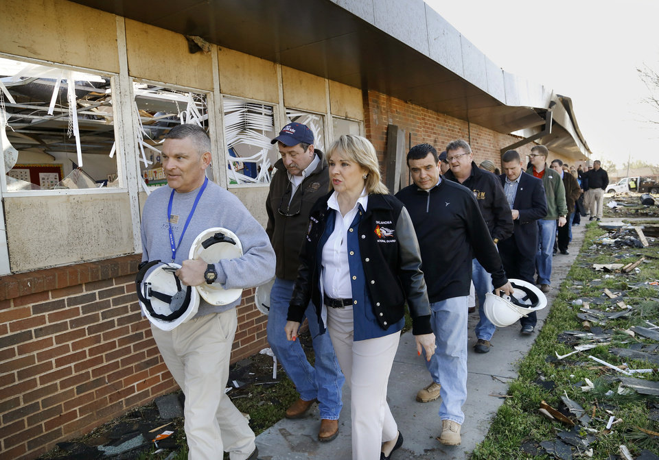 Photo - Robert Romines, superintendent, Moore Public Schools, left, leads Gov. Mary Fallin and a delegation of public officials on a tour of damage at Southgate-Rippetoe Elem. School Thursday morning, March 26, 2015, the day after a tornado damaged homes and the school.  Photo by Jim Beckel, The Oklahoman