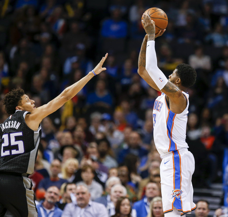 Photo - Oklahoma City's Paul George (13) shoots over Sacramento's Justin Jackson (25) during an NBA basketball game between the Oklahoma City Thunder and the Sacramento Kings at Chesapeake Energy Arena in Oklahoma City, Monday, March 12, 2018. Oklahoma City won 106-101. Photo by Nate Billings, The Oklahoman