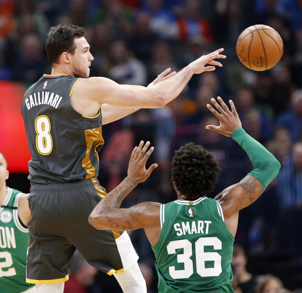 Photo - Oklahoma City's Danilo Gallinari (8) passes away from Boston's Marcus Smart (36) in the first quarter during an NBA basketball game between the Oklahoma City Thunder and the Boston Celtics at Chesapeake Energy Arena in Oklahoma City, Sunday, Feb. 9, 2020. [Nate Billings/The Oklahoman]
