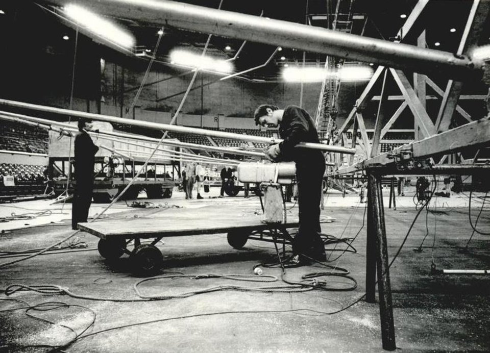 Photo - June 22, 1978: A workman rigs equipment before the opening of Ringling Bros. and Barnum & Bailey Circus. [Photo by Jim Argo, The Oklahoman Archives]