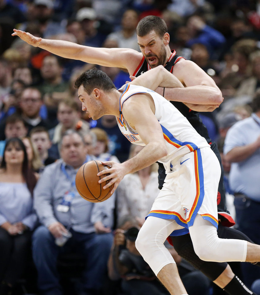 Photo - Oklahoma City's Danilo Gallinari (8) drives as Toronto's Marc Gasol (33) defends in the third quarter during an NBA basketball between the Oklahoma City Thunder and the Toronto Raptors at Chesapeake Energy Arena in Oklahoma City, Wednesday, Jan. 15, 2020. Toronto won 130-121. [Nate Billings/The Oklahoman]