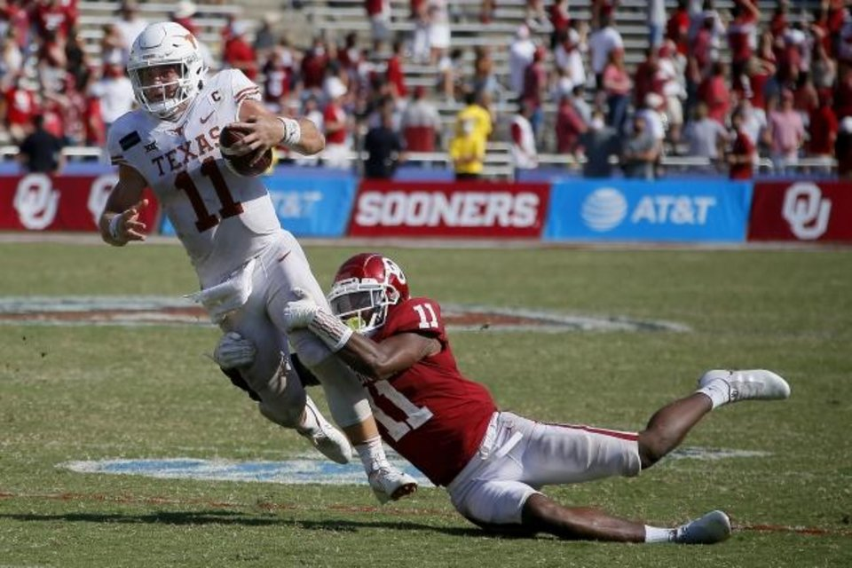 Photo -  Oklahoma lineback Nik Bonitto brings down Texas quarterback Sam Ehlinger during the Sooners' 53-45 win Oct. 10 in Dallas. [Bryan Terry/The Oklahoman]