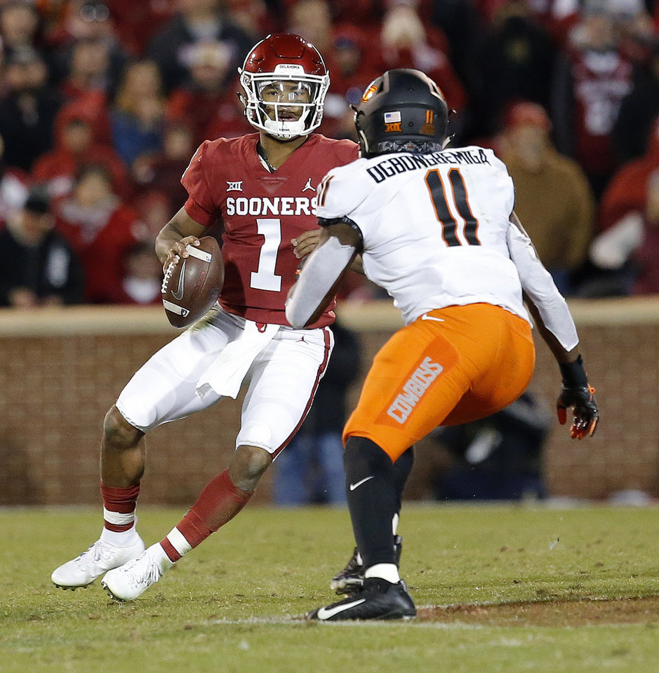 Photo - Amen Ogbongbemiga (11) pressures Oklahoma's Kyler Murray (1) during a Bedlam college football game between the University of Oklahoma Sooners (OU) and the Oklahoma State University Cowboys (OSU) at Gaylord Family-Oklahoma Memorial Stadium in Norman, Okla., Nov. 10, 2018.  OU won 48-47. Photo by Sarah Phipps, The Oklahoman