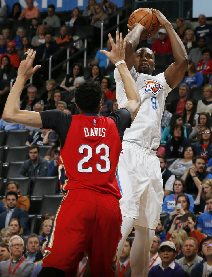 Photo - Oklahoma City's Serge Ibaka (9) shoots against New Orleans' Anthony Davis (23) during an NBA basketball game between the New Orleans Pelicans and the Oklahoma City Thunder at Chesapeake Energy Arena in Oklahoma City, Thursday, Feb. 11, 2016.  Photo by Nate Billings, The Oklahoman