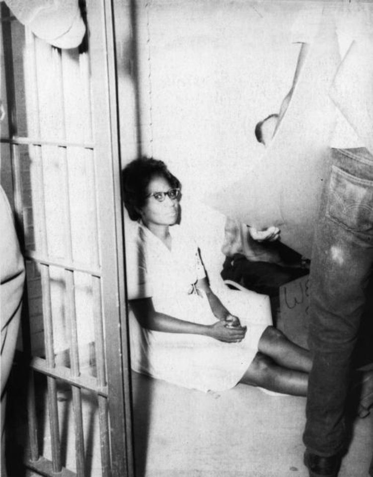 Photo -  Clara Luper, an Oklahoma City NAACP leader and a spokesman for striking city sanitation workers, is shown in this 1968 photo taken after she was jailed for blocking movement of a garbage truck.  Black trash haulers were protesting Oklahoma City's discrimination in its promotion practices.  (AP FILE PHOTO)