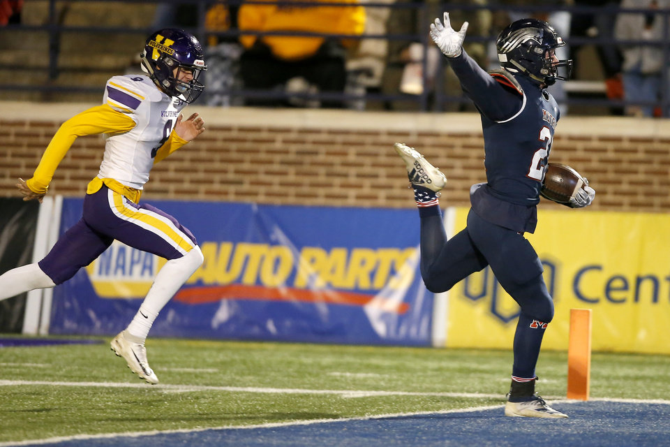 Photo - Tulsa Metro Christian's Aidan Currivean catches a touchdown pass in front of Vian's Elijah Mendoza during the Class 2A football state championship game between Tulsa Metro Christian and Vian at Wantland Stadium in Edmond, Okla., Saturday, Dec. 14, 2019. [Bryan Terry/The Oklahoman]