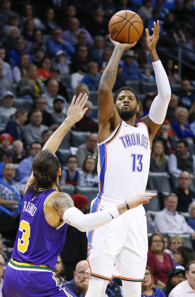 Photo - Oklahoma City's Paul George (13) shoots against Utah's Ricky Rubio (3) during an NBA basketball game between the Utah Jazz and the Oklahoma City Thunder at Chesapeake Energy Arena in Oklahoma City, Monday, Dec. 10, 2018. Oklahoma City won 122-113. Photo by Nate Billings, The Oklahoman