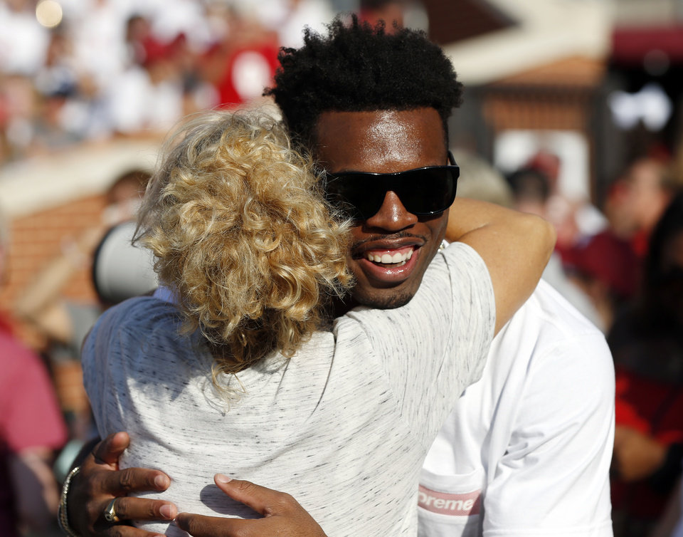 Photo - Former OU basketball player Buddy Hield gets a hug from OU women's basketball coach Sherri Coale before a college football game between the Oklahoma Sooners (OU) and South Dakota Coyotes at Gaylord Family - Oklahoma Memorial Stadium in Norman, Okla., Saturday, Sept. 7, 2019. [Nate Billings/The Oklahoman]