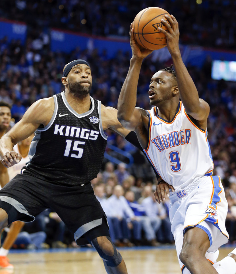 Photo - Oklahoma City's Jerami Grant (9) drives against Sacramento's Vince Carter (15) during an NBA basketball game between the Oklahoma City Thunder and the Sacramento Kings at Chesapeake Energy Arena in Oklahoma City, Monday, March 12, 2018. Photo by Nate Billings, The Oklahoman