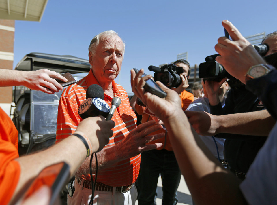 Photo - Boone Pickens talks with the media after speaking with the Oklahoma State football team during a practice in Stillwater, Okla., Friday, April 10, 2015. Photo by Bryan Terry, The Oklahoman