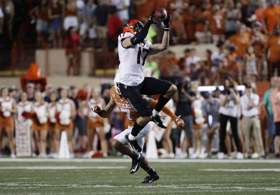 Photo - Oklahoma State wide receiver Dillon Stoner (17) makes a catch against Texas during the second half of an NCAA college football game Saturday, Sept. 21, 2019, in Austin, Texas. (AP Photo/Eric Gay)