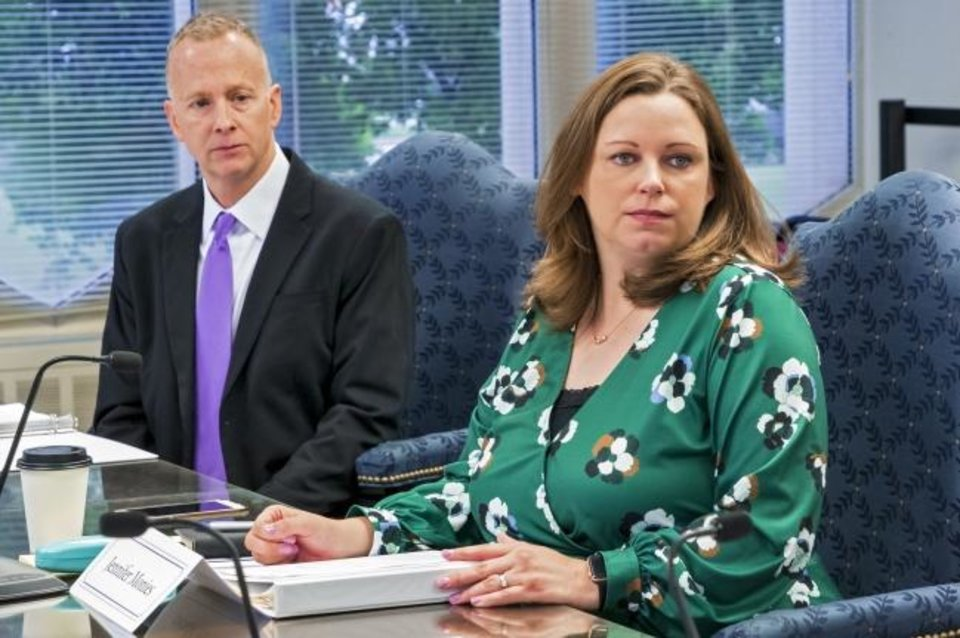 Photo -  New state Board of Education appointees   Brian Bobek and Jennifer Monies listen during a board meeting Thursday in Oklahoma City.  [Chris Landsberger/The Oklahoman]
