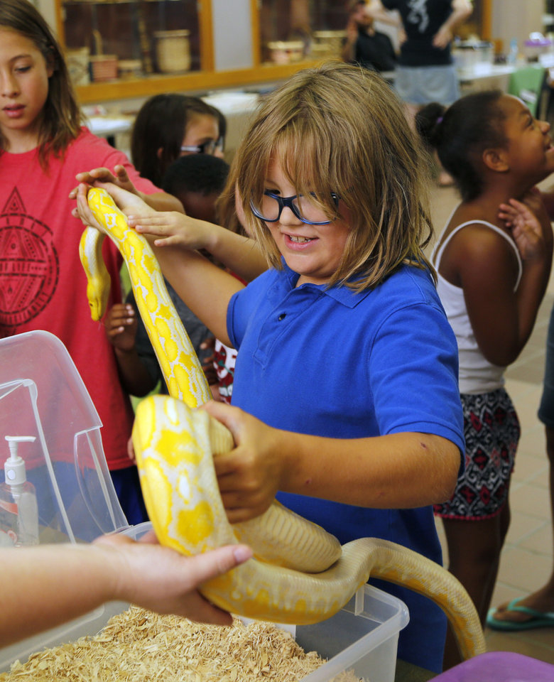 Snakes on display at summer camp at Midwest City Library
