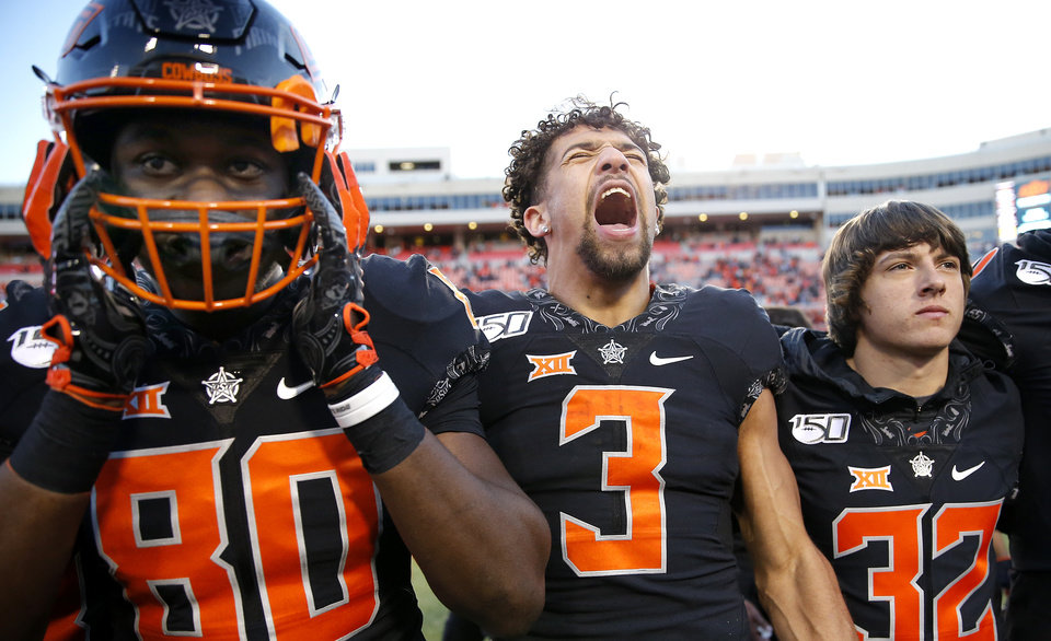Photo - Oklahoma State's Spencer Sanders (3) celebrates next to LC Greenwood (80) following the college football game between the Oklahoma State University Cowboys and the TCU Horned Frogs at Boone Pickens Stadium in Stillwater, Okla.,  Saturday, Nov. 2, 2019. [Sarah Phipps/The Oklahoman]