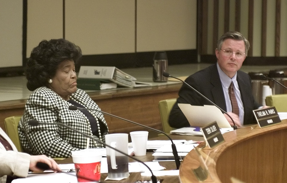 Photo - Oklahoma City School Board member Thelma Parks has a difference of opinion with Board Chairman Cliff Hudson during the proceedings of the OKC School Board meeting.  Photo by Paul Hellstern