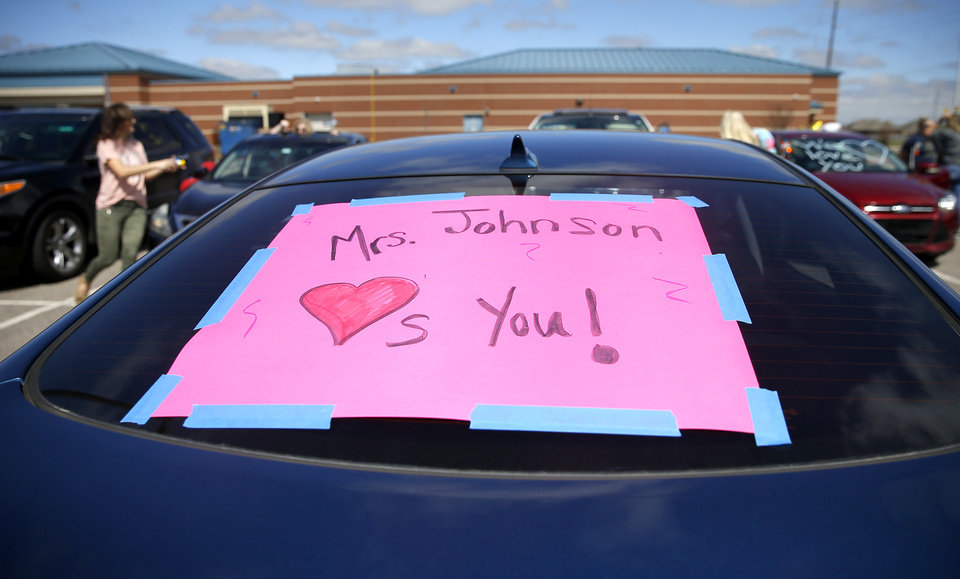 Photo - Cars are decorated as they wait to start an Oakridge Elementary faculty caravan in neighborhood around the Moore school, Tuesday, March 24, 2020. [Bryan Terry/The Oklahoman]