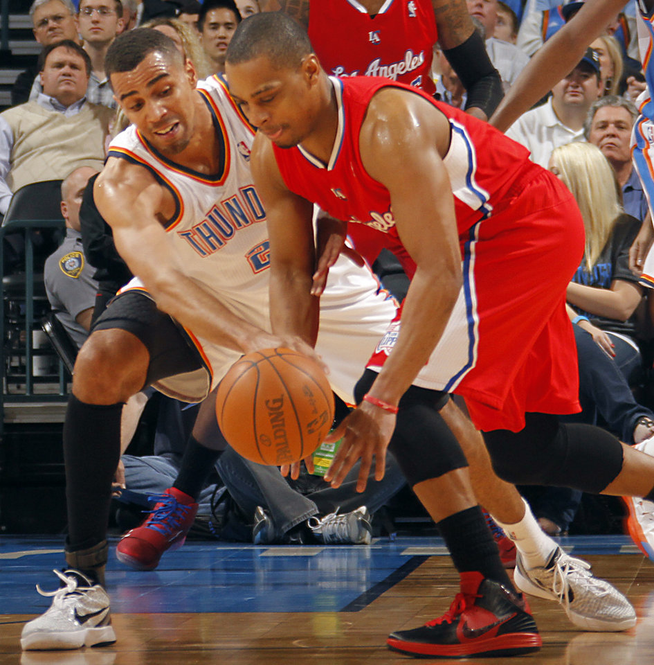 Photo - Oklahoma City Thunder shooting guard Thabo Sefolosha (2) defends on Los Angeles Clippers guard Randy Foye (4) during the NBA basketball game between the Oklahoma City Thunder and the Los Angeles Clippers at Chesapeake Energy Arena on Wednesday, March 21, 2012 in Oklahoma City, Okla.  Photo by Chris Landsberger, The Oklahoman