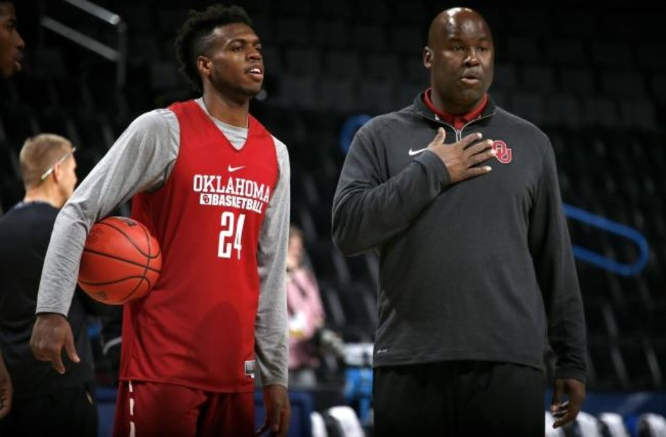 Photo -  Former OU star Buddy Hield, left, talks with assistant Chris Crutchfield in 2016. Crutchfield is in his first year as the head coach at East Central University in Ada, a move he made to coach his two sons but also get head coaching experience. [Bryan Terry/The Oklahoman]