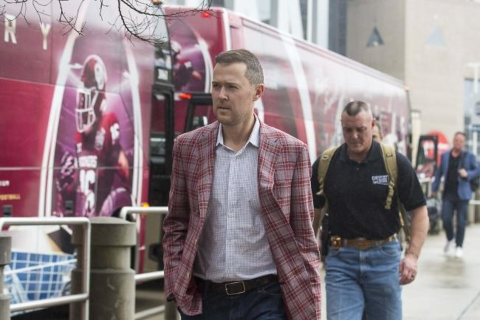 Photo -  Coach Lincoln Riley arrives with the Sooners at the Omni Hotel in Atlanta on Monday ahead of Saturday's playoff semifinal against LSU. [Alyssa Pointer/Atlanta Journal-Constitution via AP]