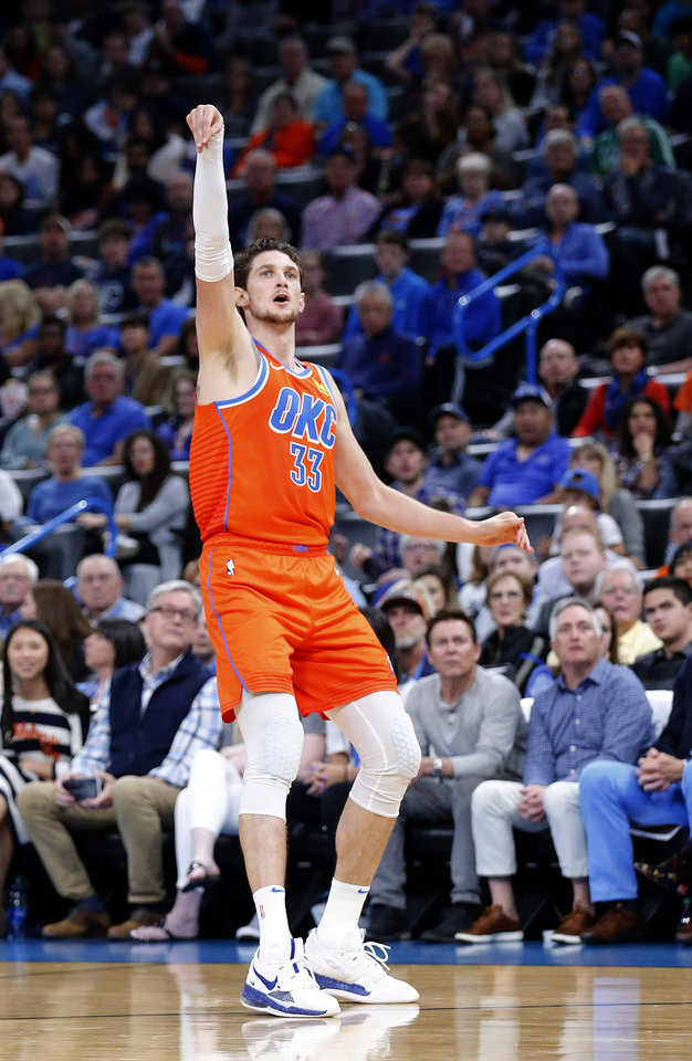 Photo - Oklahoma City's Mike Muscala (33) reacts after a 3-point basket during the NBA game between the Oklahoma City Thunder and the Milwaukee Bucks at Chesapeake Energy Arena,   Sunday, Nov. 10, 2019.  [Sarah Phipps/The Oklahoman]