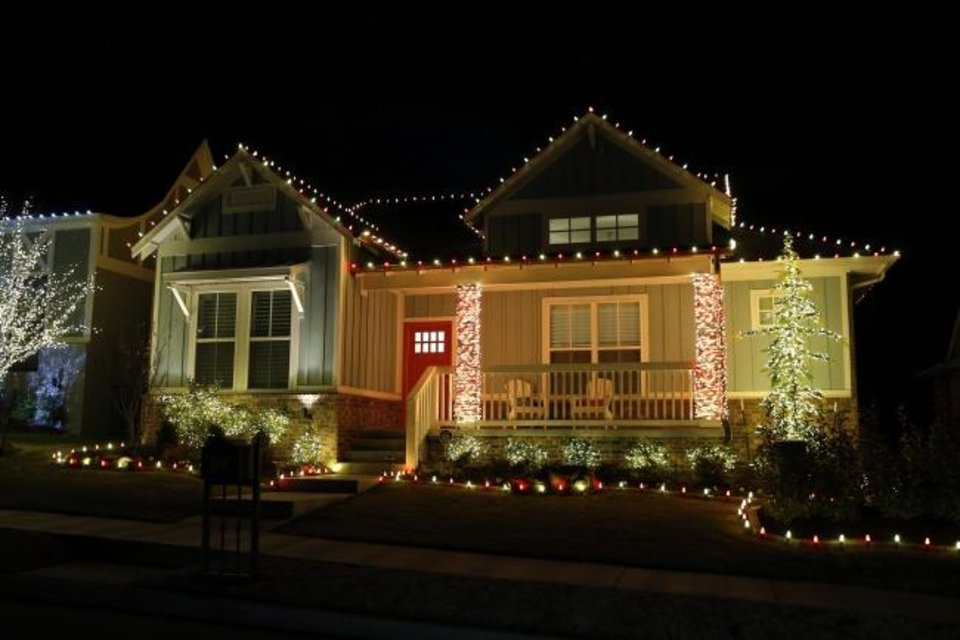 Photo -  The home at 1708 Boathouse Road in Edmond is decked for the holidays. [CHRIS LANDSBERGER/THE OKLAHOMAN]