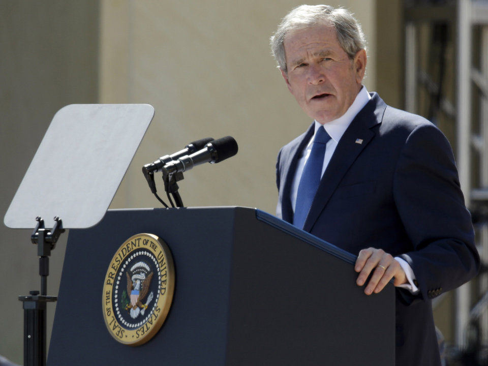 Photo - File - In this April 25, 2013 file photo, former President George W. Bush speaks during the dedication of the George W. Bush Presidential Center in Dallas. Bush has successfully undergone a heart procedure after doctors discovered a blockage in an artery. Bush spokesman Freddy Ford says a stent was inserted during a procedure Tuesday, Aug 6, 2013 at Texas Health Presbyterian Hospital in Dallas. (AP Photo/Tony Gutierrez, Pool, File) ORG XMIT: TXKJ101