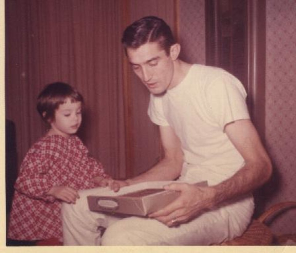 Photo -  Columnist Paula Burkes is shown with her father, Don Burkes. [PHOTO PROVIDED]