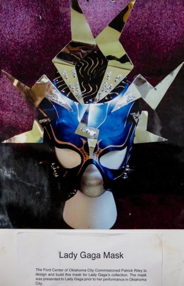Photo -  A photo of a mask created by G. Patrick Riley for Lady Gaga is displayed at his home studio in Bethany on July 29. Riley, who is renowned for his colorful masks, has a variety of his work on view in the exhibit