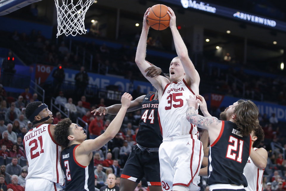 Photo - Oklahoma's Brady Manek (35) grabs a rebound between Texas Tech's Clarence Nadolny (2), Chris Clarke (44) and Avery Benson (21) as Oklahoma's Kristian Doolittle (21) watches during a men's NCAA college basketball game between the University of Oklahoma Sooners (OU) and the Texas Tech Red Raiders at Chesapeake Energy Arena in Oklahoma City, Tuesday, Feb. 25, 2020. Oklahoma won 65-51. [Bryan Terry/The Oklahoman]