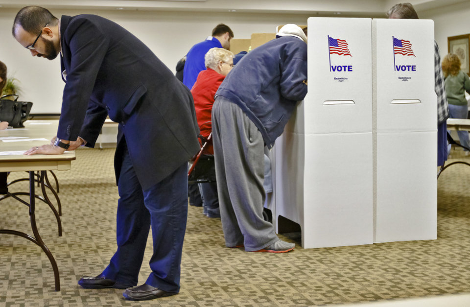 Photo - James Craig fills out his ballot during election day on Tuesday, Nov. 6, 2012, in Yukon, Oklahoma. Photo by Chris Landsberger, The Oklahoman