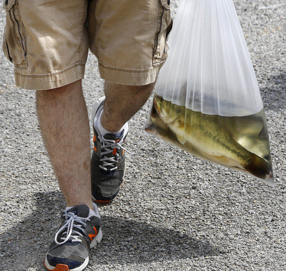 Photo -  Eating fish is generally considered a healthy food choice, but the Oklahoma Department of Environmental Quality cautions against eating too many fish from certain state lakes because of mercury levels found in some species. [PHOTO BY JIM BECKEL, THE OKLAHOMAN]