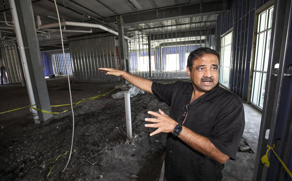 Photo -  FILE - In this Oct.  23, 2019 file photo, Developer Danny Gaekwad talks about the Food Hall on the first flood while giving a tour the Hilton Garden Inn hotel that is presently under construction in Ocala, Fla.  Since the coronavirus crisis started, hotel owners say they are struggling to get relief on a type of loan that Wall Street investors buy.  [Doug Engle/Ocala Star-Banner via AP)
