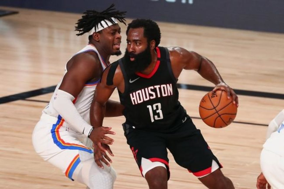 Photo -  Houston's James Harden (13) drives against Oklahoma City's Luguentz Dort (left) during the Thunder's 117-114 Game 4 win Monday in Lake Buena Vista, Fla. [Kim Klement/USA TODAY Sports]