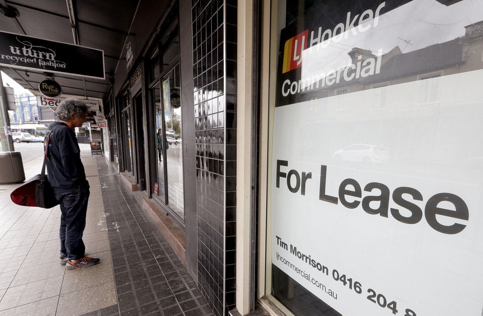 Photo -  A man stops next to a commercial property for lease in Sydney, Tuesday, Oct. 6, 2020. The Australian government will reveal a big spending financial blueprint for the next few years that will drive business investment and job creation while repairing pandemic damage to the economy. (AP Photo/Rick Rycroft)