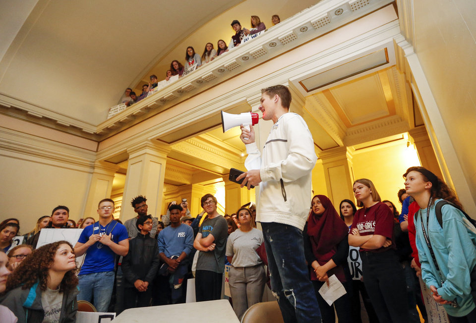 Photo - Jayke Flaggert, a Choctaw High School junior, speaks at a rally led by students on the second floor of the state Capitol during the eighth day of a walkout by Oklahoma teachers, in Oklahoma City, Monday, April 9, 2018. Photo by Nate Billings, The Oklahoman