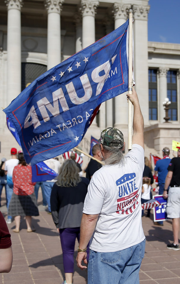 Photo - People gather during a rally for President Trump at the Oklahoma state Capitol in Oklahoma City,  Saturday, Nov. 7, 2020. [Sarah Phipps/The Oklahoman]