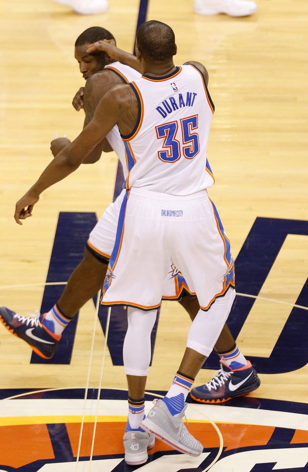 Photo - Oklahoma City's Kevin Durant (35) and Dion Waiters (3) celebrate during Game 3 of the Western Conference finals in the NBA playoffs between the Oklahoma City Thunder and the Golden State Warriors at Chesapeake Energy Arena in Oklahoma City, Sunday, May 22, 2016. Photo by Sarah Phipps, The Oklahoman