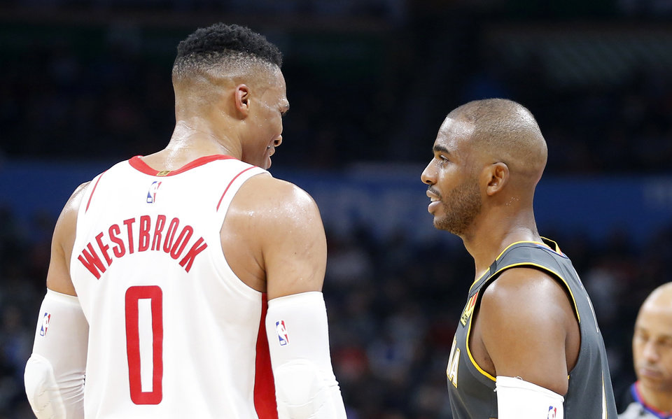 Photo - Players who were traded for each other in the offseason — Houston's Russell Westbrook and Oklahoma City's Chris Paul — will likely be vying over one of the Western Conference's last all-star spots. [Bryan Terry/The Oklahoman]