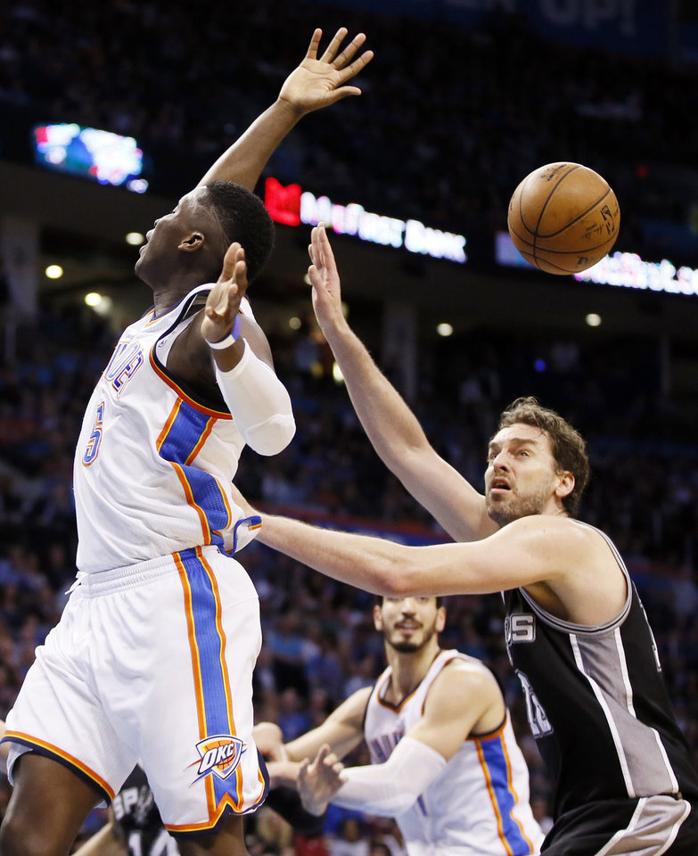 Photo - Oklahoma City's Victor Oladipo (5) turns the ball over in front of San Antonio's Pau Gasol (16) in the second half during an NBA basketball game between the Oklahoma City Thunder and San Antonio Spurs at Chesapeake Energy Arena in Oklahoma City, Friday, March 31, 2017. San Antonio won 100-95. Photo by Nate Billings, The Oklahoman