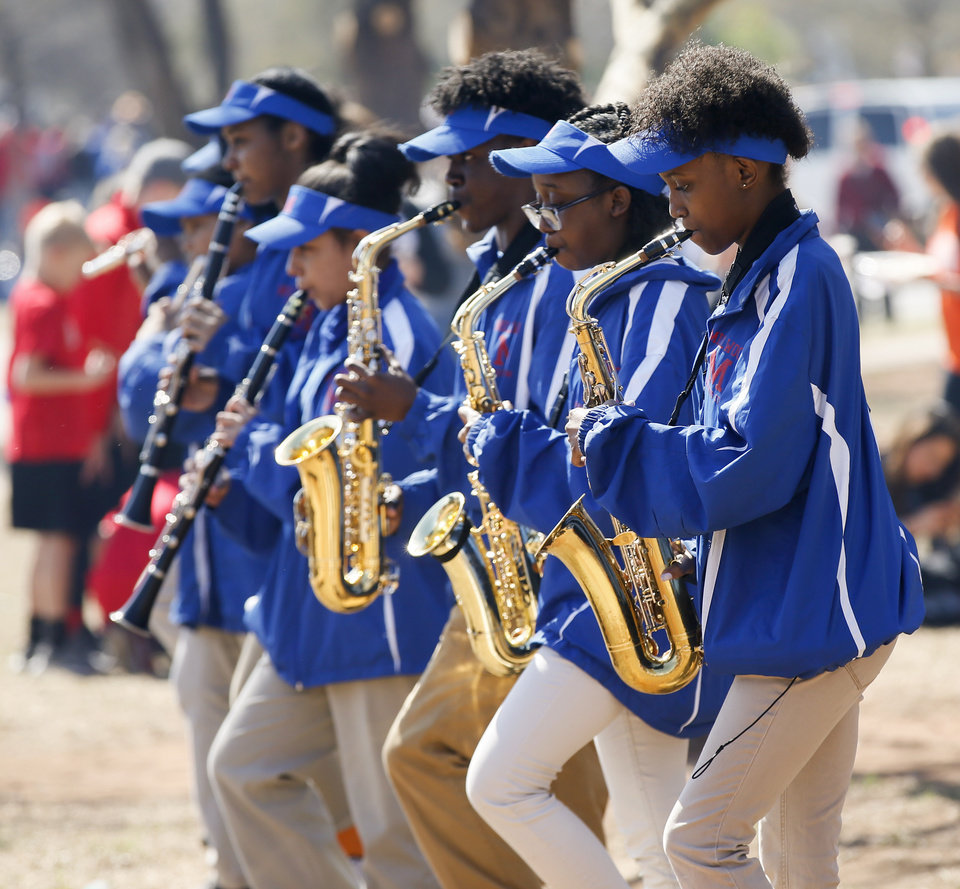 Photo - The Millwood Marching Storm plays on the south side of the state Capitol during the eighth day of a walkout by Oklahoma teachers, in Oklahoma City, Monday, April 9, 2018. Photo by Nate Billings, The Oklahoman